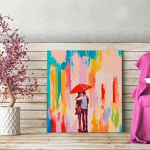 Obraz do samodzielnego malowania – Para pod parasolem (różowe tło) – 45×45